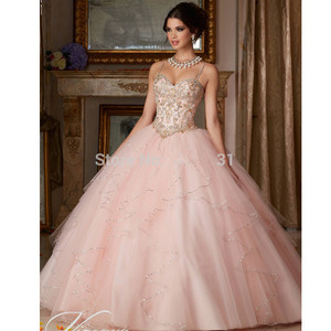 Image 1 - Blush Pink Cheap Quinceanera Dresses Ball Gown Spaghetti Straps Tulle Beaded Crystals Sweet 16 Dresses