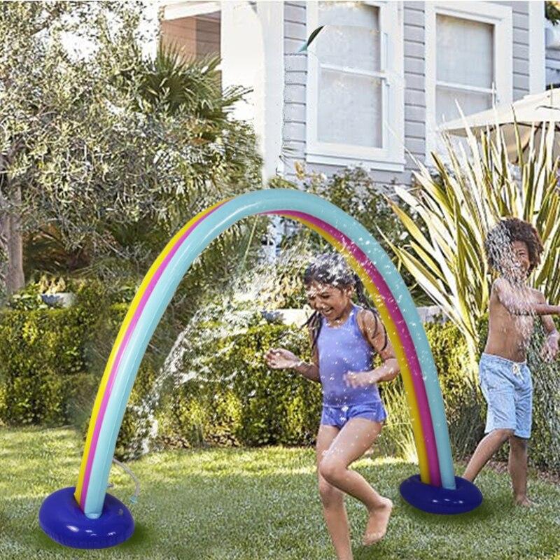 Enfants en plein air drôle arc-en-ciel nuage cour arroseur géant gonflable arche pelouse plage jouets pour enfants adulte bébé jeux Center