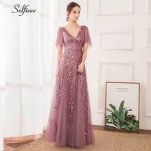 Женское платье макси из тюля с длинным рукавом и оборками расшитое