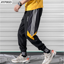 купить New 2019 Spring Fashion Mens Striped Pants Joggers Black Grey Elastic Waist Harajuku Streetwear Hip Hop Men Harem Trousers M-5XL по цене 1121.31 рублей