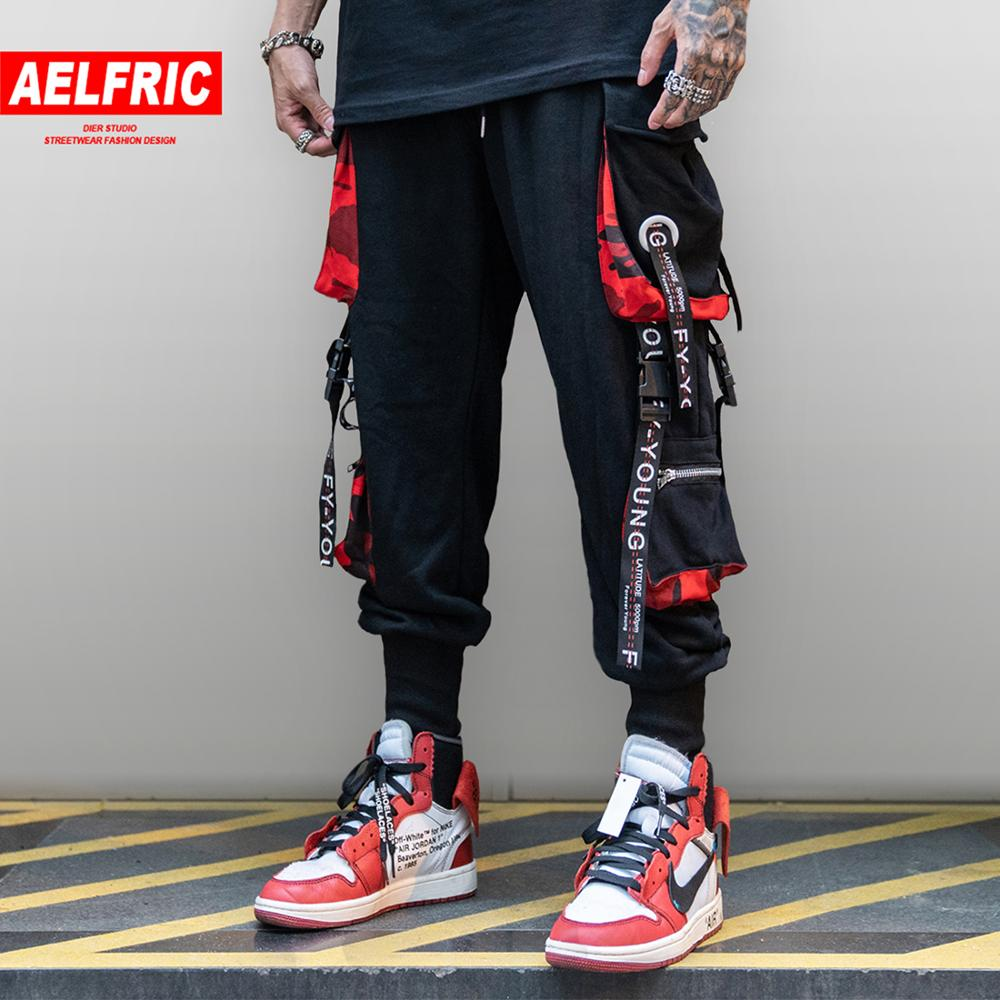 AELFRIC Multi Pockets Ribbons Mens Cargo Pants Hip Hop Harajuku Streetwear Patchwork Elastic Waist Casual Joggers Track Trousers