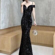 Gengli حزمة الأرداف فستان ذيل السمكة 2020 شتاء جديد كلمة الكتف مزاجه نوبل الأسود الإناث ستار حفلة عيد ميلاد