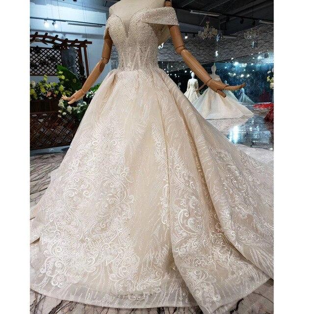 BGW HT43028 Sexy hors de lépaule robe de mariée avec longue Train dentelle Appliques perlée chérie luxe robe de mariée nouvelle arrivée