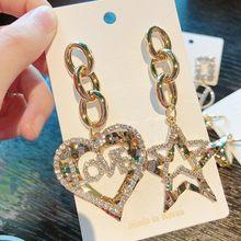 MENGJIQIAO koreański dżet Hollow serce kolczyki wiszące w kształcie gwiazdki dla kobiet moda asymetryczny metalowy łańcuch Oorbellen Party biżuteria