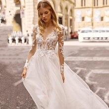 Свадебное платье с длинными рукавами и аппликацией кружевное