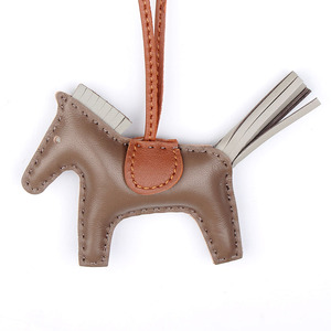 Image 3 - Designer Famous Brand Luxury Soft Real Genuine Leather Cute Horse Keychain Pendant For Backpack Animal Key Chain Women Bag Charm