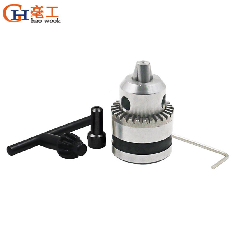 UNIVERSAL CHUCK HAS SINGLE COLLET ROUND ROTATING WOOD HANDLE GRAVER DRILL REAMER