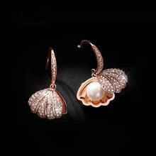 Изысканные элегантные висячие серьги из розового золота с ракушками