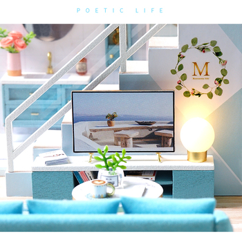 living room of the blue doll house sofa, tv, chair, flowers