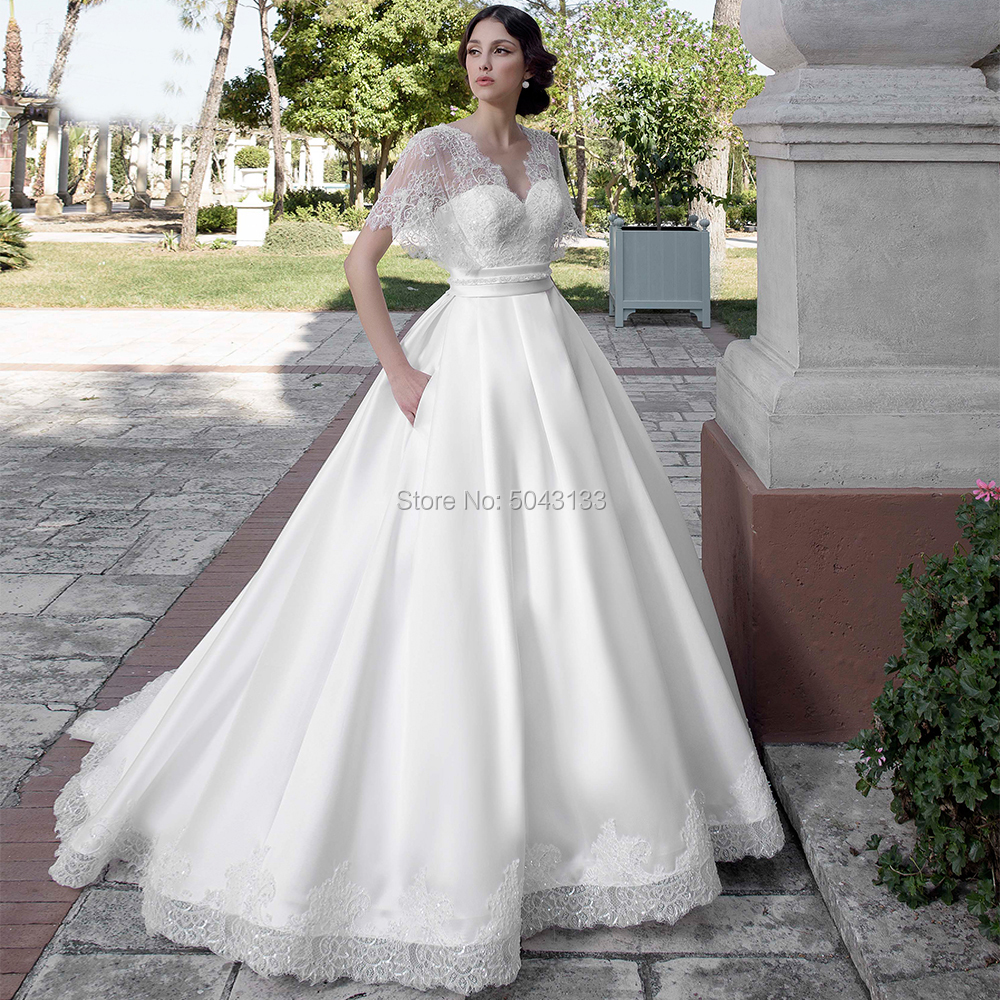 Elegant Satin A Line Wedding Dresses 2020 Exquisite Lace Sweetheart Neck Short Sleeves Backless Wedding Bridal Gown With Pockets