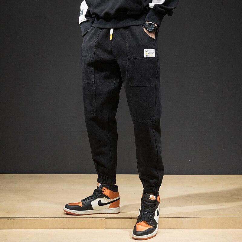 Fashion Streetwear Men Jeans Loose Fit Spliced Designer Casual Cargo Pants Harem Jeans Black Color Hip Hop Joggers Pants Hombre