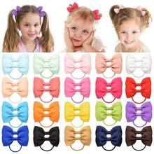 20 Pcs/lot solide ruban gros-grain arcs pour bébé filles porte-queue de cheval bandes de cheveux élastique corde à la main bandeau cheveux accessoires