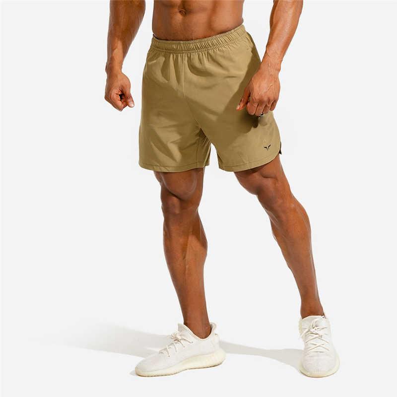 Yeni erkek spor vücut geliştirme şort erkek yaz egzersiz erkek nefes hızlı kuru spor Jogger plaj kısa pantolon
