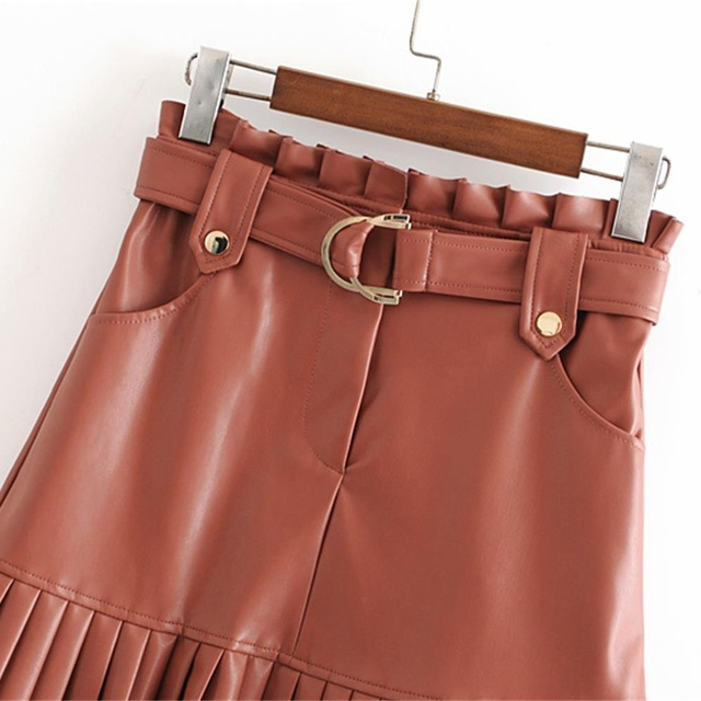 New fashion trend of autumn women's wear in 2019 small pleated imitation leather mini-step cake skirt 4