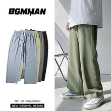 Wiosenne letnie jednokolorowe spodnie dorywczo męskie koreańskie modne luźne spodnie z prostymi nogawkami męskie Streetwear lodowy jedwab mopem spodnie męskie