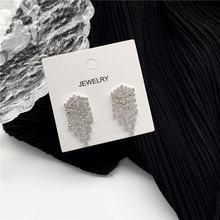 Металлические серьги с кисточками и кристаллами модный Джокер