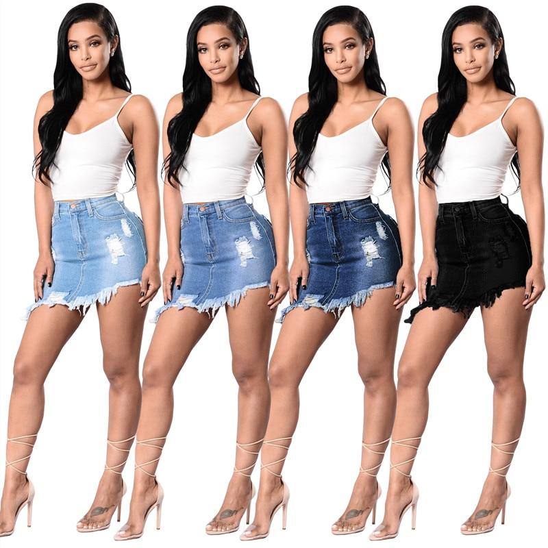 Venta al por mayor, Falda vaquera informal de verano para mujer, Falda corta asimétrica con agujero de Color sólido, falda de calle de cintura alta para mujer