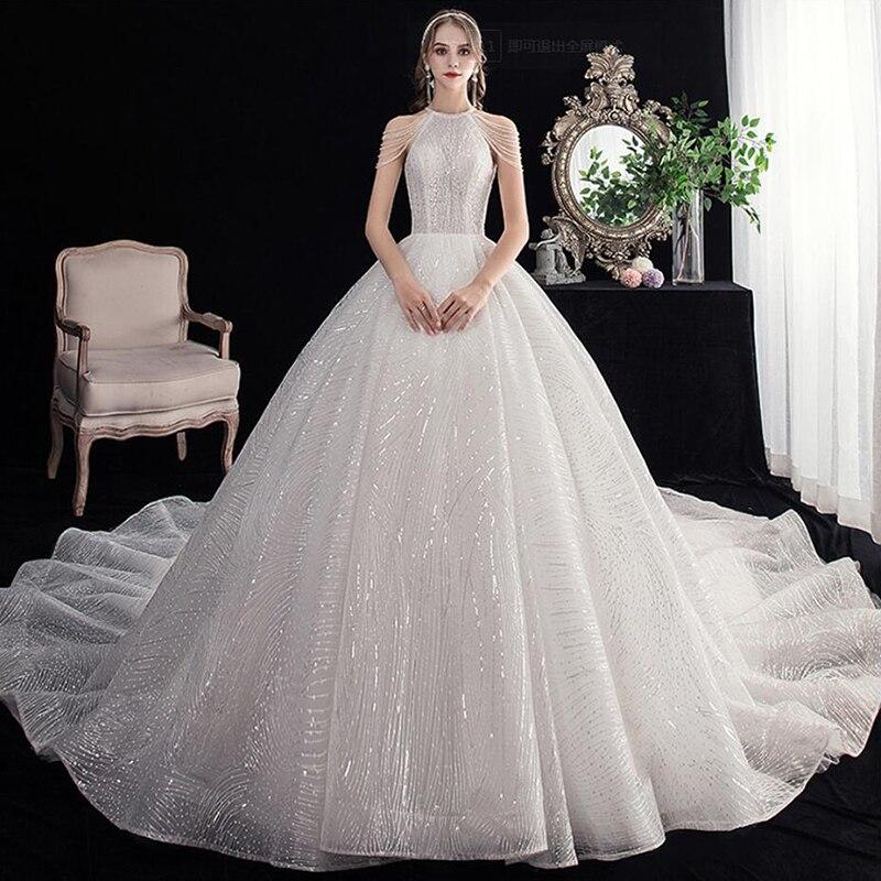 2020 New Halter Neck Bling Sequins Pearls Luxury Wedding Dress Bride Gowns Wedding Bridals Gown Royal Train Vestido De Noiva