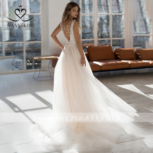 Image 2 - Sexy Beaded Backless Wedding Dress Swanskirt NR22 V neck Appliques Lace A Line Court Train Princess Bride Gown Vestido de Noiva