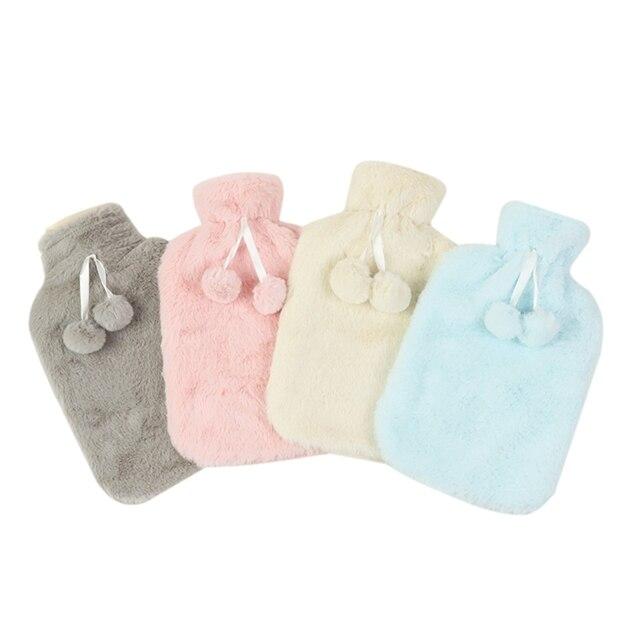 Bouillotte fluffy avec pompon couleur unie Bouillottes Fluffy Textile Cocooning.net