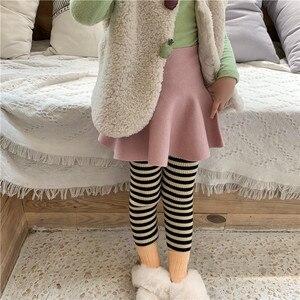 Image 5 - Bebek Kız Yüksek Bel Yün Etek çocuk şemsiyesi Etek Saf Renk Çocuklar Tüm Maç Etek KidsGirls Giyim