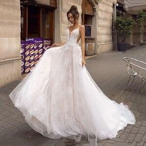Image 1 - ローリー A ライン背中のウェディングドレス 2019 セクシーなスパゲッティストラップブライダルドレス 3D レース花の妖精ビーチウェディングドレス