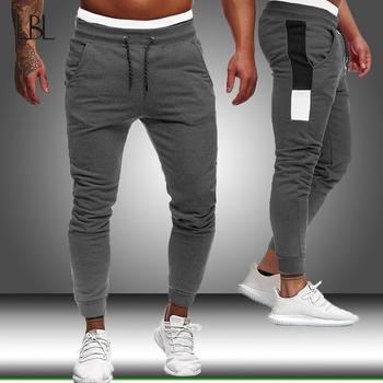 Spodnie do joggingu męskie spodnie sportowe spodnie do biegania męskie spodnie do biegania spodnie do biegania dopasowane obcisłe spodnie spodnie kulturystyczne męskie Streetwear tanie i dobre opinie LBL LEADING THE BETTER LIFE Ołówek spodnie CN (pochodzenie) Mieszkanie Poliester NONE skinny 2 - 2 5 Pełnej długości