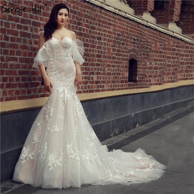 فساتين الزفاف 2020 جديد الصيف الدانتيل الزهور مثير سليم حورية البحر زي العرائس رداء دي ماريج سيرين هيل HM66348