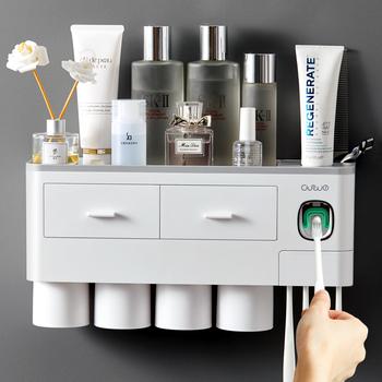 Adsorpcja magnetyczna odwrócony uchwyt na szczoteczki do zębów automatyczny dozownik pasty do zębów z kubkiem pasta do zębów zestaw akcesoriów łazienkowych tanie i dobre opinie Z tworzywa sztucznego CF048 Ekologiczne Zaopatrzony Dwuczęściowe Toothpaste toothbrush rack gray pink blue ABS PP 23*10*18 8cm