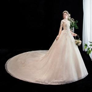 Image 3 - Moda elegancka suknia ślubna na szyję luksusowe koronki muzułmańska suknia ślubna 2020 nowy szampan długi pociąg aplikacja księżniczka Brida Robe De Mariee