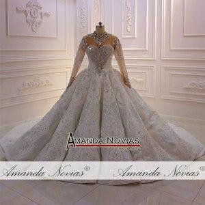 Image 4 - トップ高級ヘビービーズウェディングドレス黒花嫁デザインのウェディングドレスブライダルメイクアップ 2020