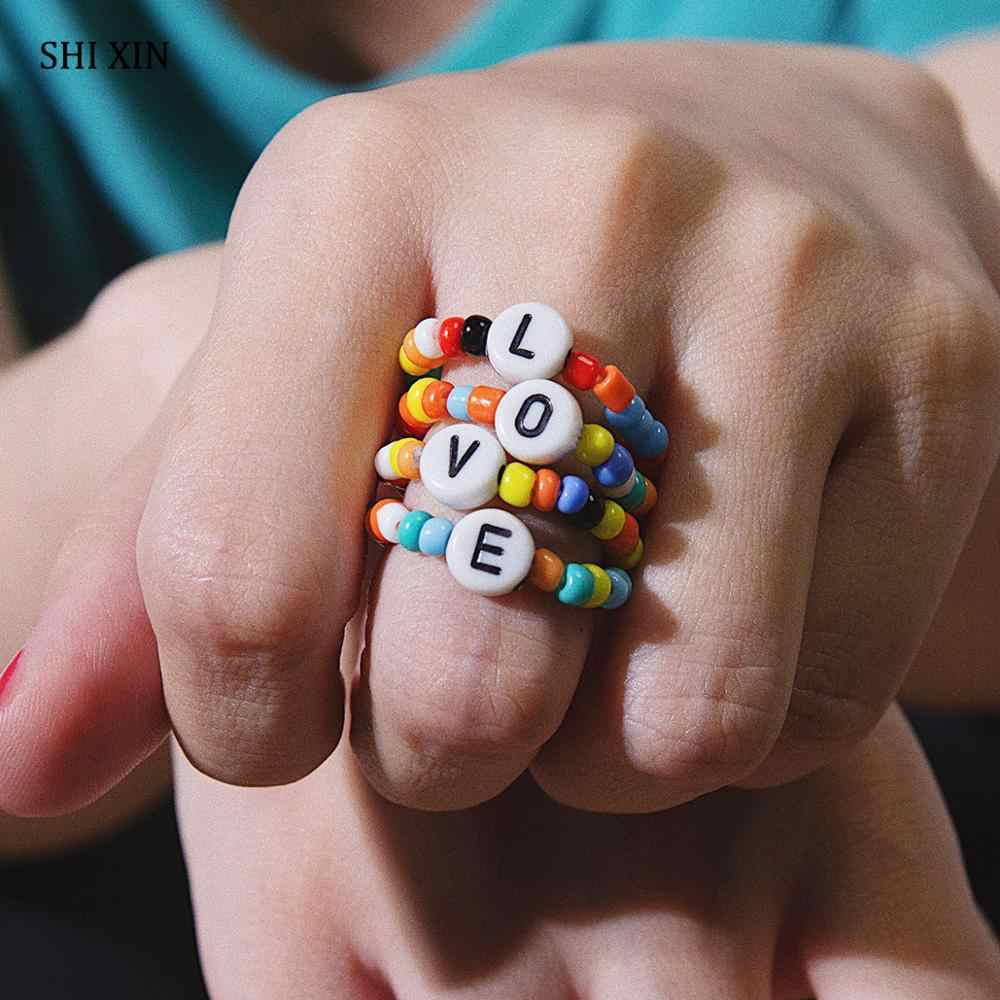 Shixin Nhiều Màu Sắc Nhỏ Hạt Vòng Cho Nữ Hợp Thời Trang Dễ Thương Thun Chữ LOVE Nhẫn Bộ Xếp Chồng Boho Rainbow Nhẫn Ngón Tay Trang Sức