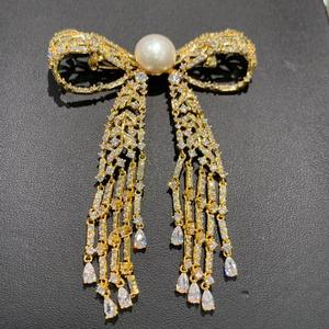 Image 1 - 11 12MM natural fresh water pearl brooch copper with cubic zircon bowknot brooch pins tassels classic fashion women jewelry