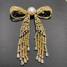 11 12MM naturalna perła słodkowodna broszka miedź z sześcienną cyrkonią broszka z kokardką szpilki frędzle klasyczna moda damska biżuteria