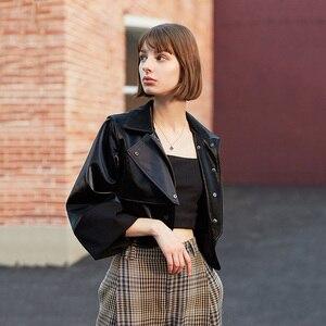 Image 3 - [EAM] luźny krój czarny asymetryczna kurtka ze skóry sztucznej nowa z klapami z długim rękawem płaszcz damski moda fala wiosna jesień 2020 1H079