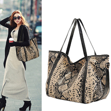 New leather handbags European and American leather shoulder bag shoulder bag big bag mommy bag new serpentine hit color wild leather handbags european and american fashion trapezoidal buckle shoulder diagonal bag leather ha