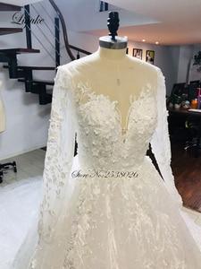 Image 2 - فستان عروس من Liyuke بأكمام طويلة لحفلات الزفاف مع دانتيل رائع من قطار مصلى