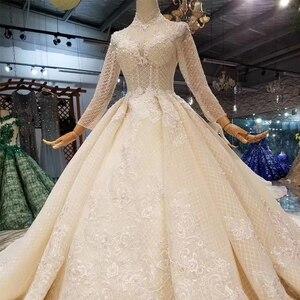 Image 4 - LSS446 ארוך שרוולי חתונת שמלות גבוהה צוואר פתוח keyhole חזרה שמלות כלה תחרה אפליקציות לראות דרך 웨딩 파티 드레스