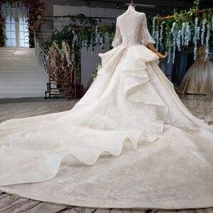 Image 2 - HTL984 boho weselny strój koronki pół rękawa latarnia koronki na szyję dziurka od klucza powrót luksusowe suknie ślubne wzburzyć pociąg vestido boda