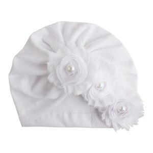 Nishine младенческой новорожденных шапки с шифоновые цветы с жемчужинами Хлопок Смесь Kont тюрбан девочек эластичный Beanie Hat Детские аксессуары для волос