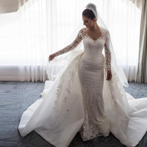 Image 2 - 2020 Luxury Mermaid Wedding Dresses Sheer Neck Long Sleeves Illusion Full Lace Applique Bow Overskirts Button Back Chapel Train