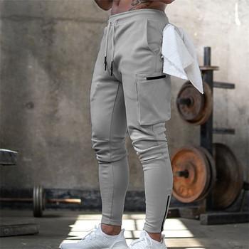 Męskie spodnie dresowe Jogger Pnats męskie siłownie treningowe fitnessowe bawełniane spodnie męskie spodnie dorywczo mody Skinny spodnie do biegania Zipper design spodnie tanie i dobre opinie HANQIU Na co dzień Sznurek Mieszkanie Pełnej długości COTTON Poliester REGULAR Kieszenie Men Pants Midweight Suknem