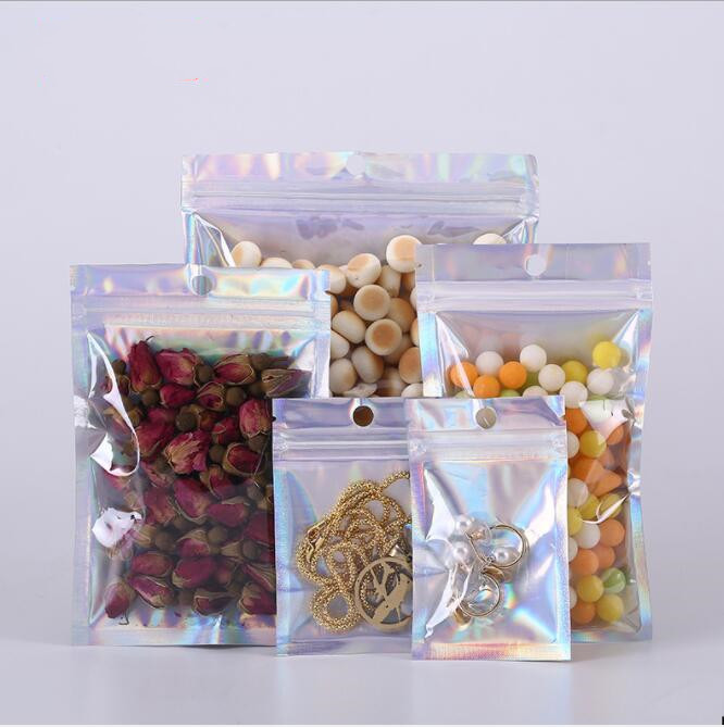 50pcs 7 10cm PET Holographic Zip Lock Bag Laser Foil Pouch Reusable Jewelry Packaging Small Food Pouch Bag in Storage Bags from Home Garden
