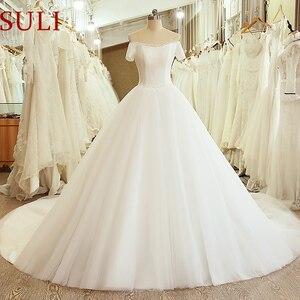 Image 1 - SL 5054 księżniczka próbka suknia ślubna gorset suknia z ramienia z krótkim rękawem koronkowy pas tanie suknia ślubna chiny