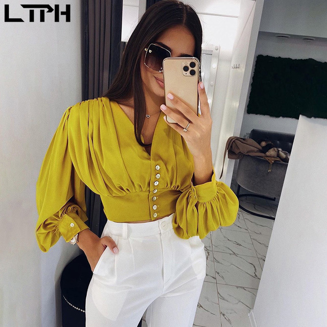 Hot sale 2020 Spring new womens tops and blouses Sexy V-neck Lantern sleeves Fashion Shoulder Pleated Short Solid dew Navel top