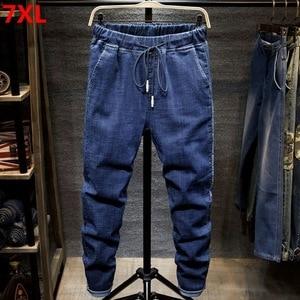 Image 1 - Large size jeans black mens  man plus size harem pants autumn elastic stretch Slim feet trousers 7XL 6XL 5XL
