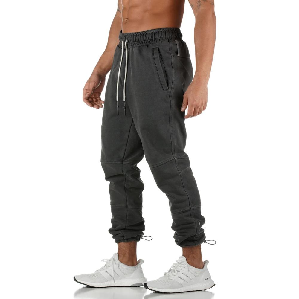 New men's sportswear trousers men's cotton bodybuilding splice can be hung towel training elastic rope trousers?clearance sale