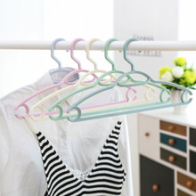Buy Multi-Function Plastic Non-Slip Hanger Wardrobe Storage Rack Wrinkle-Free Shirt Hanger Portable Coat Closet Outdoor Drying directly from merchant!