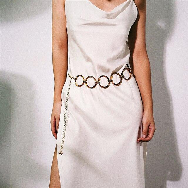 Фото женский леопардовый ремень с кисточками украшенный кругом новый