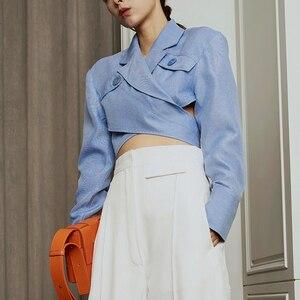 Image 3 - TWOTWINSTYLE Asymmetrische Slanke vrouwen Blouses Revers Kraag Lange Mouwen Casual Short Shirts Tops Vrouwelijke Mode Kleding 2019 Nieuwe